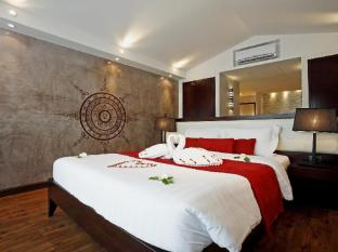 The Village Coconut Island Beach Resort Phuket - Chambre