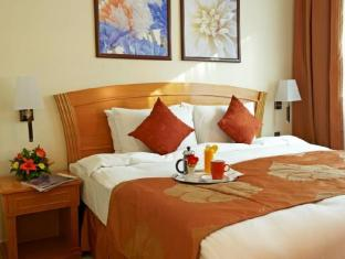 Golden Tulip Hotel Apartments Sharjah - Guest Room