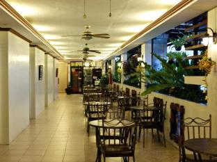Ecoland Suites Davao City - Inne i hotellet