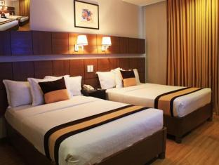 Pinnacle Hotel and Suites Davao City - חדר שינה