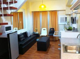 East of Galleria Condominium Manila - 1BR unit - Living & dining area