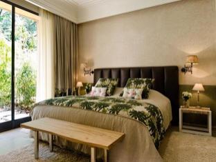 Tigmiza Suites & Pavillons Marrakesch - Gästezimmer