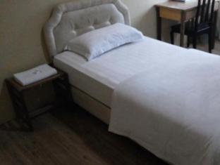 Rafflesia Inn Kuching - Chambre