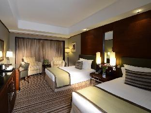 Grand Millennium Hotel Dubai guestroom junior suite