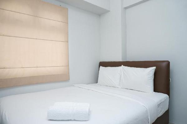 Tranquil Green Pramuka 2BR Apartment By Travelio Jakarta