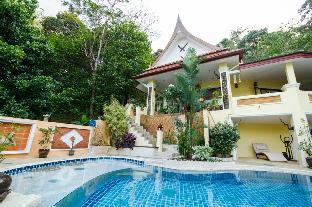 villa with swiming pool in tropical garden