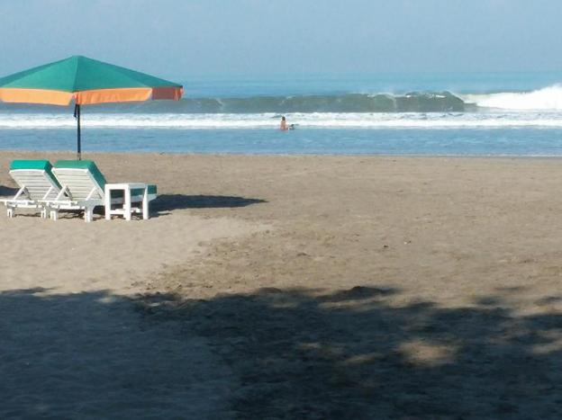 Puri Naga Beachfront Cottages