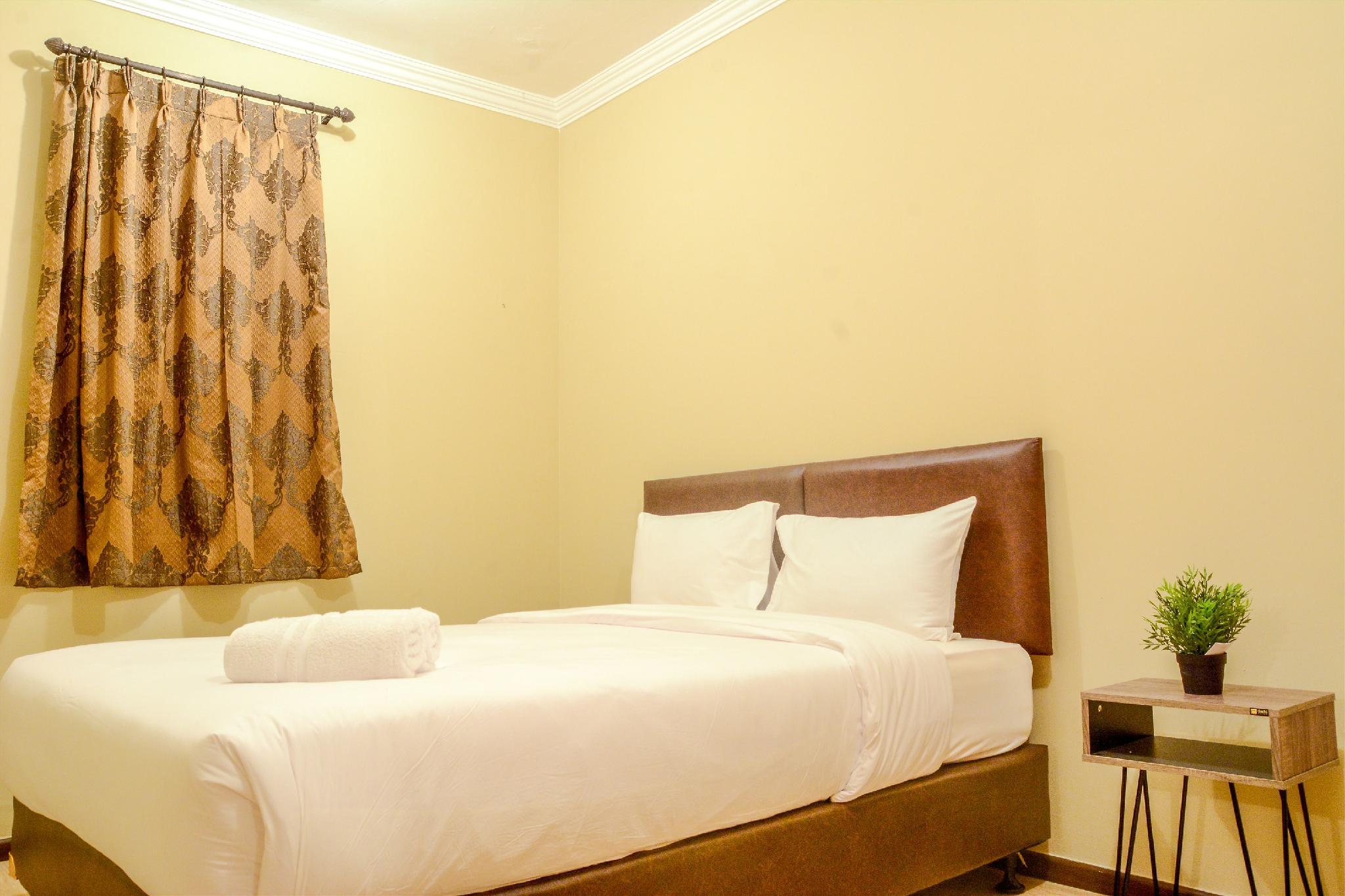 Simply And Clean 2BR Grand Palace Apt By Travelio