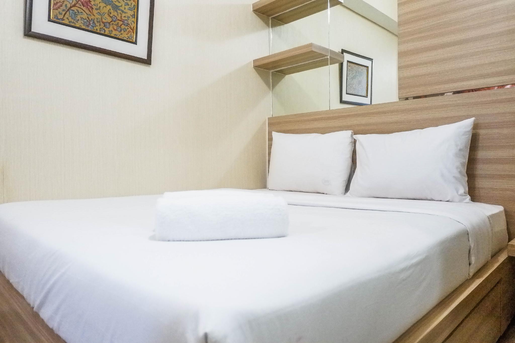 Homey 2BR Apartment @Tamansari Papilio By Travelio