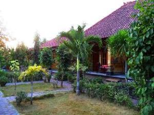 關於努莎德瓦他島平房 (Nusa Dewata Bungalows)