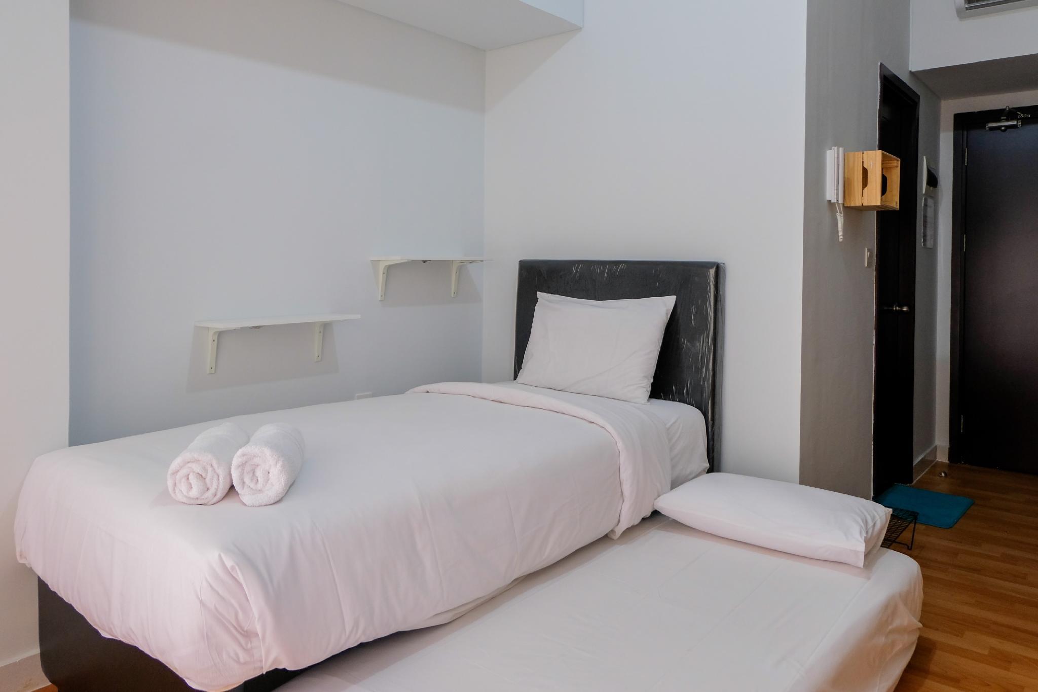 Homey Studio Room At Casa De Parco Apt By Travelio
