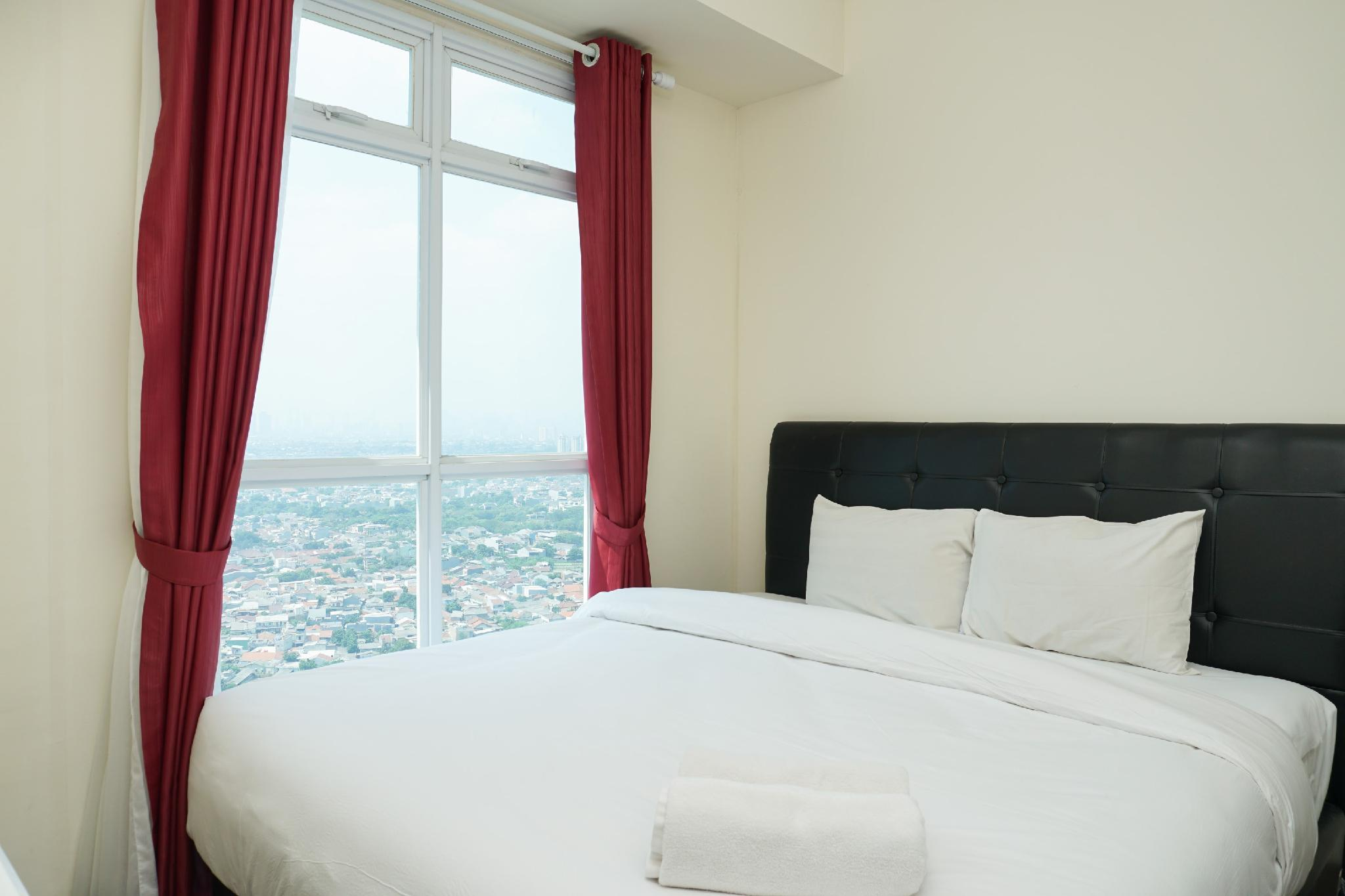 Comfortable 2BR Puri Orchard Apartment By Travelio