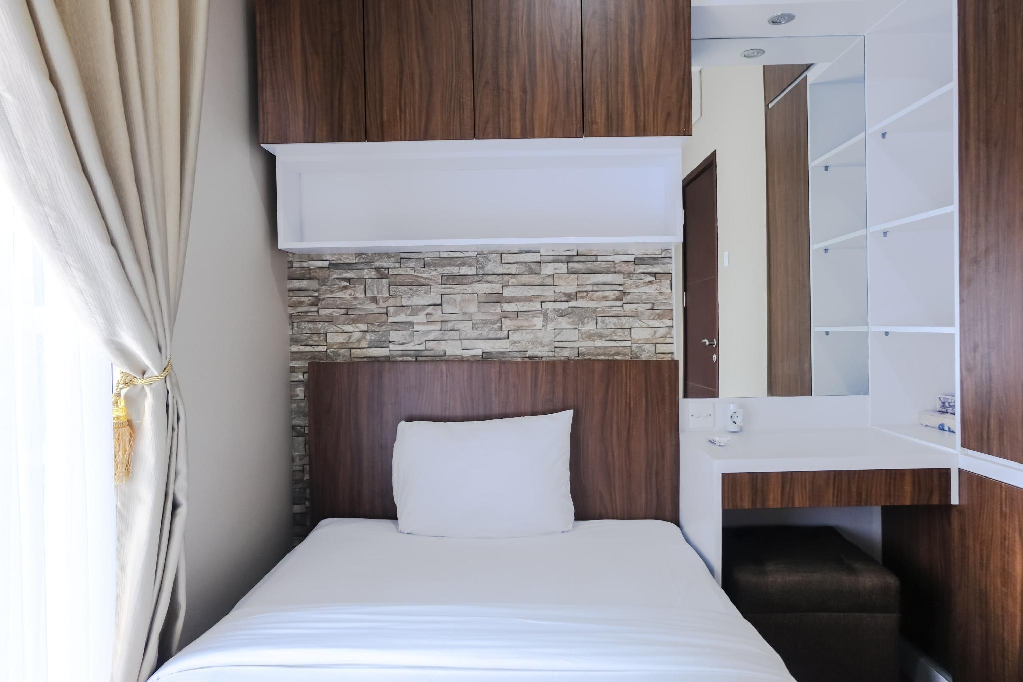 Comfortable 2BR @Springwood Apartment By Travelio